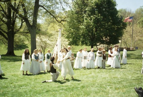 Dressed in white, the May Day Revelers re-create the May Pole Dance.